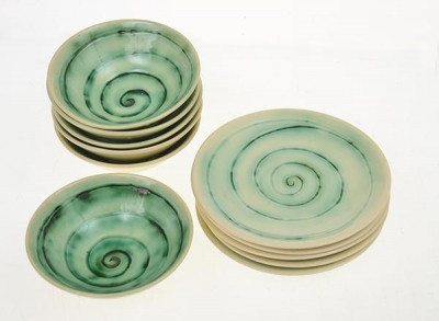 Set of six swirl decorated bowls with underplates. Martin Boyd.